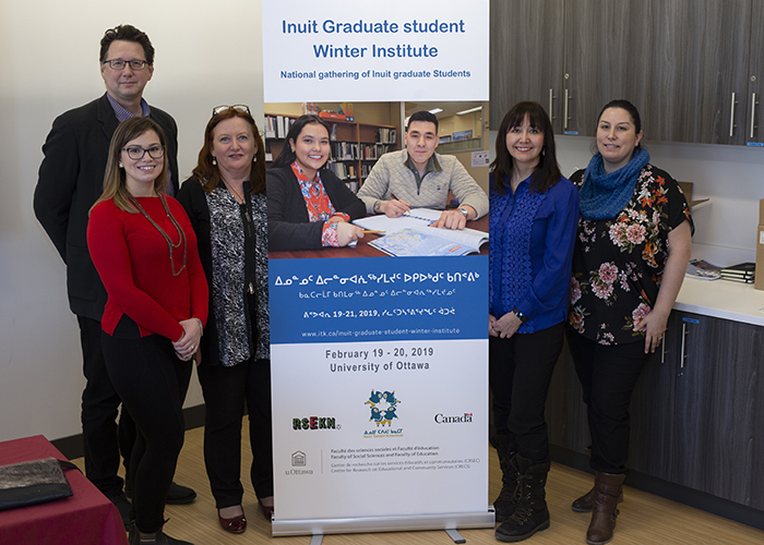 Five members of the organizing committee of the Inuit Graduate Student Winter Institute standing one beside each other.