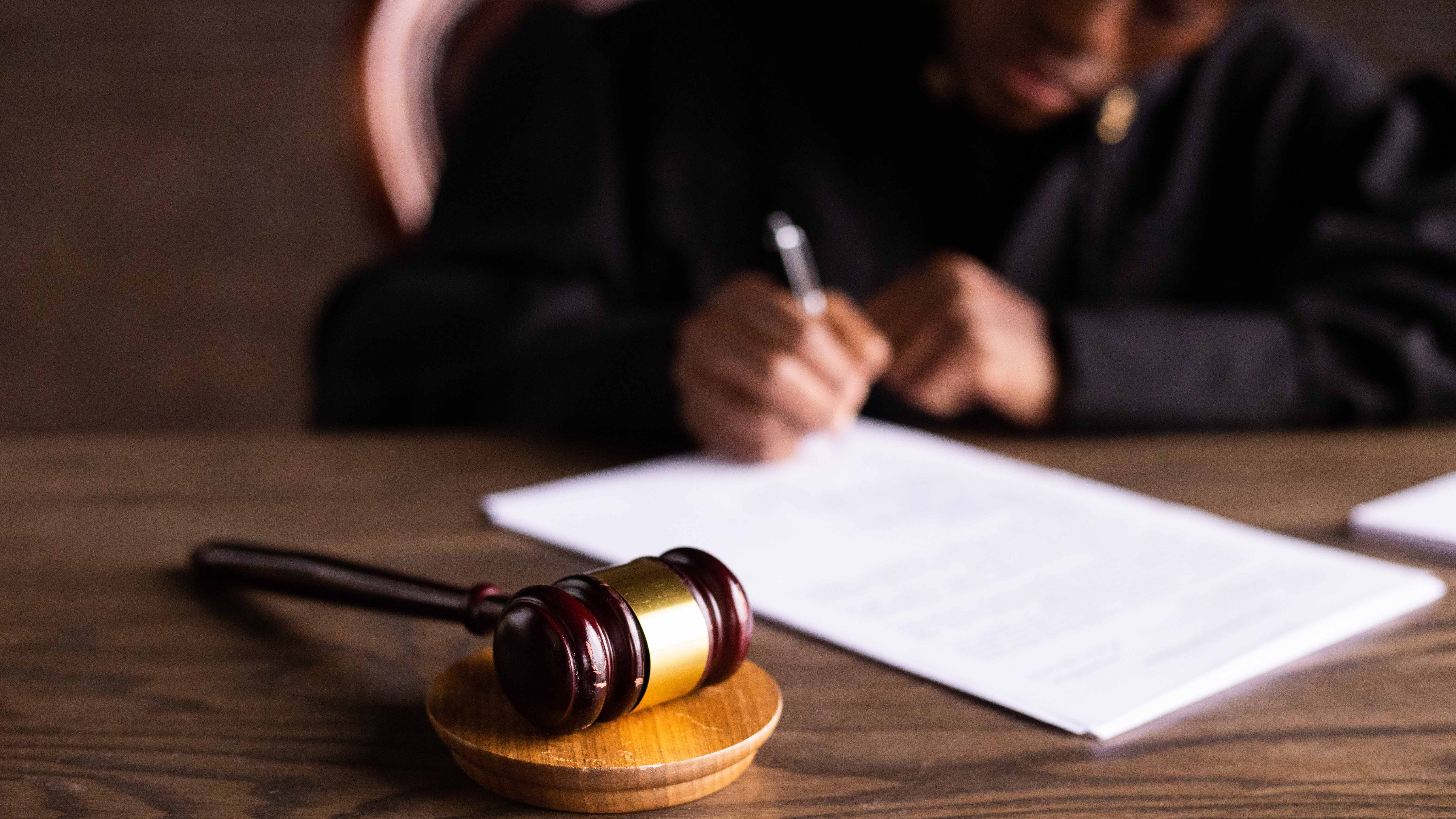 A gavel is placed in front of a judge.