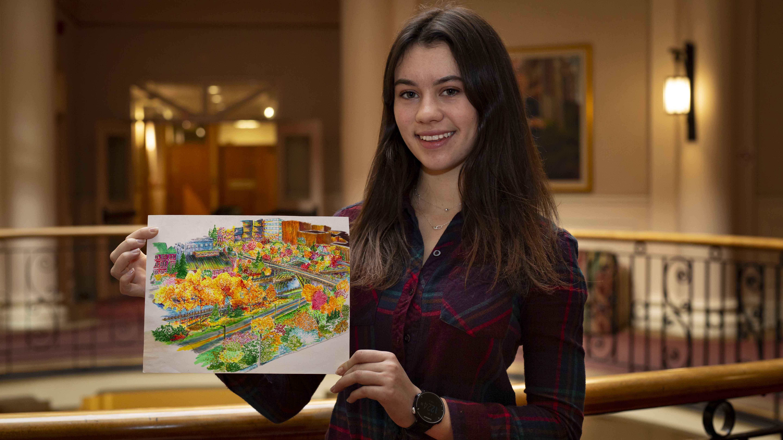 Kira F. Robinson tenant son oeuvre d'art faite d'un assortiment de surligneurs et de stylos